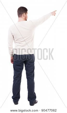 Back view of pointing business man. gesticulating young guy in black suit. Rear view people collection.  backside view of person.  Isolated over white background.  The bearded guy shows up right.