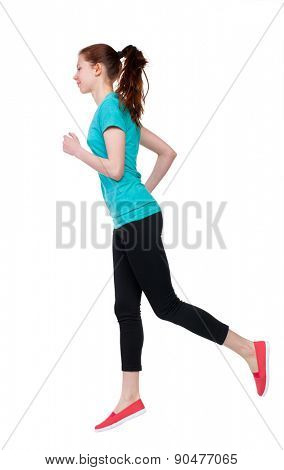 back view of running sport woman. beautiful girl in motion. backside view of person.  Rear view people collection. Isolated over white background. Girl in sportswear jogging