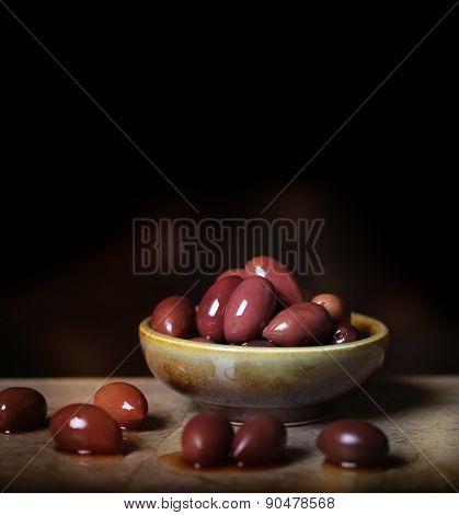 Kalamata Olives In Ceramic Bowl