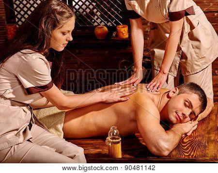 Man  having oil Ayurveda wooden spa treatment.