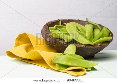 Snow Peas On Wooden Bowl
