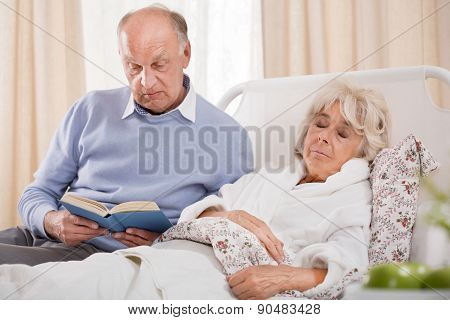 Husband Reading Ill Wife Book