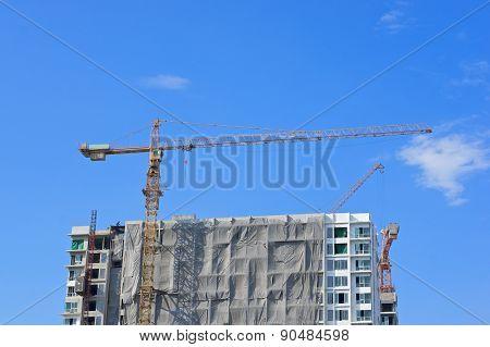 Big Crane And Construction Skyscraper With Blue Sky