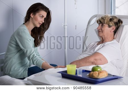 Daughter Assisting Ill Mother