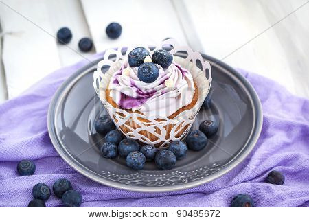 Tasty Blueberry Cupcake On Plate