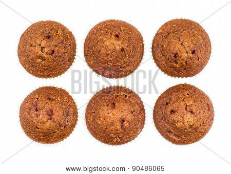 Six Muffins In Row Isolated On White