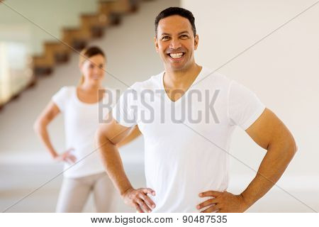 happy middle aged man standing in front wife after exercise at home