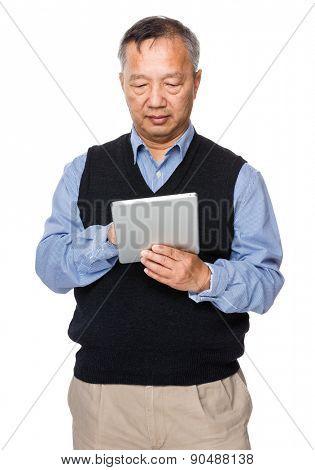 Asian old man use of digital tablet