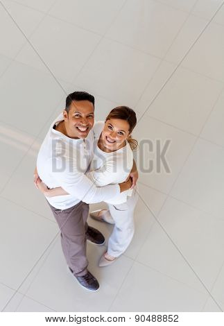 top view of middle aged couple in their new house