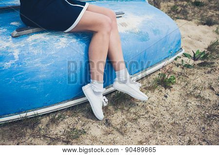 Woman Sitting On A Boat By The Seaside