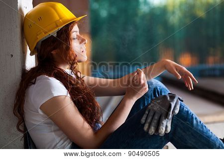 Woman Bricklayer Smoking