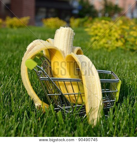 mini shopping cart with banana outdoor in green grass