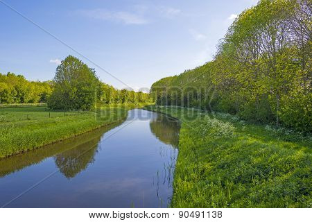 Canal meandering through the countryside in spring