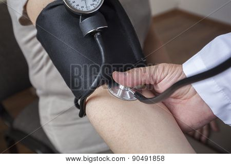 Doctor Is Measuring A Blood Pressure Of A Patient