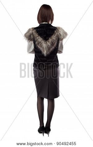 Woman in fur jacket turned back