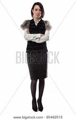 Woman in fur jacket with arms crossed