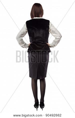 Young woman in fur jacket turned back