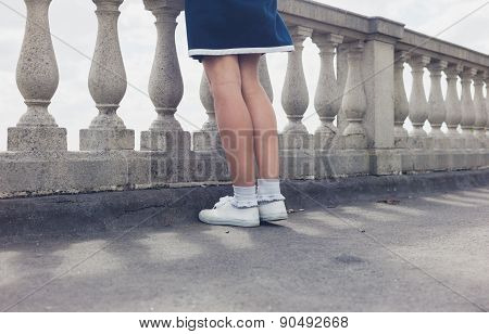 Woman Standing By Balustrades