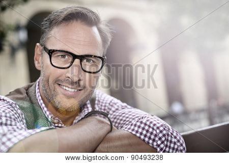 Trendy handsome man with eyeglasses in the street