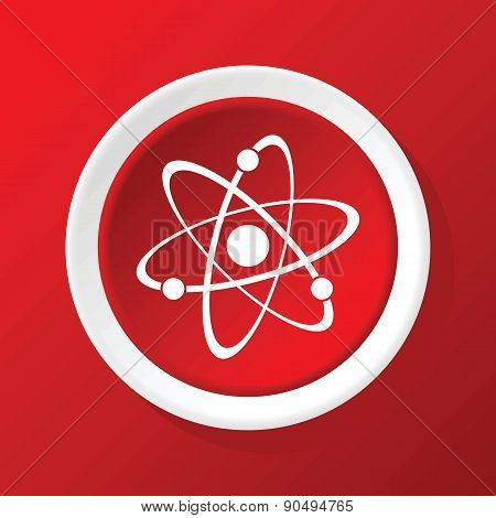 Atom icon on red