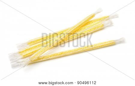 Milk banana flavoring straws isolated on white