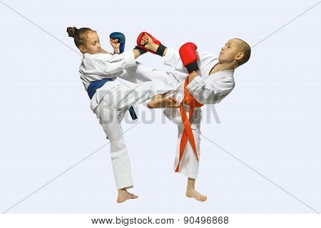 Sportsmen with overlays on hands are training hitting  mawashi geri
