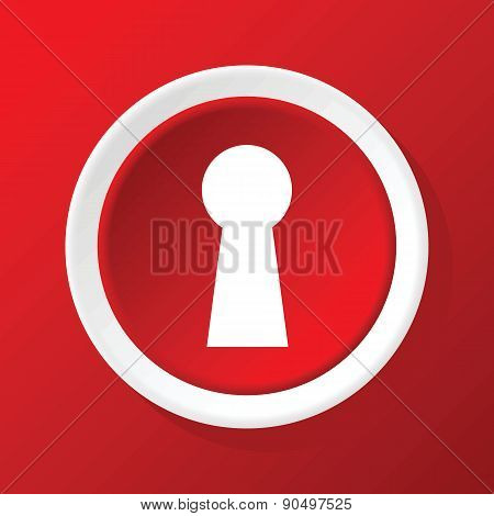 Keyhole icon on red