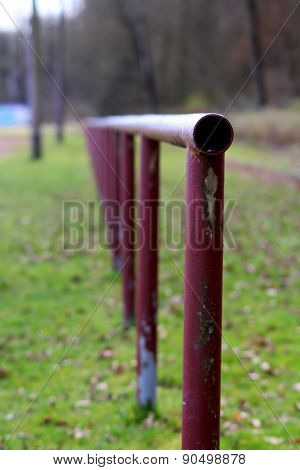 A Fence Made Of Metal Pipes