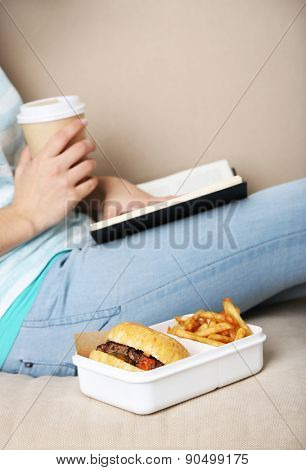 Woman with unhealthy fast food, close-up
