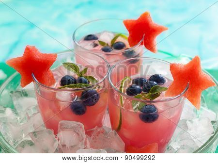 Watermelon and blueberry drink in glasses with slices of watermelon in star shape