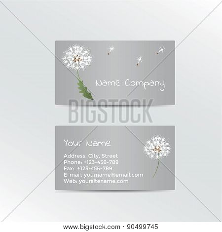 Business card with dandelion on grey background.
