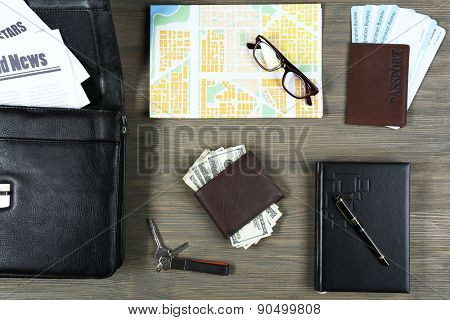 Set of business trip stuff on wooden background