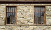 picture of tile cladding  - Stone cladding plates on the wall with two window - JPG