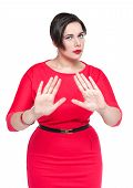foto of dress-making  - Beautiful plus size woman making stop gesture isolated - JPG