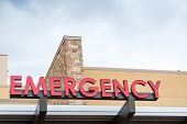 stock photo of emergency treatment  - Emergency sign leading to a modern hospital - JPG