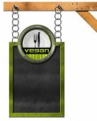 picture of food chain  - Blackboard with metal frame hanging from a chain on wooden pole vegan symbol with empty white plate and silver cutlery - JPG