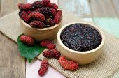 stock photo of mulberry  - home made mulberry jam in wooden bowl and some fresh fruits and - JPG