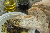 stock photo of vinegar  - Sliced Ciabatta bread with olive oil and balsamic vinegar - JPG