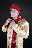 foto of sherwani  - A young Indian guy wearing a traditional royal costume - JPG