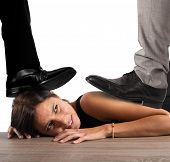 stock photo of humiliation  - Businesswoman exploited by her boss in office - JPG