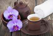 picture of black tea  - Asian tea set with orchid black tea on a wooden background - JPG