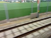 picture of train track  - tracks and rails out in movement from a moving train - JPG