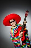 pic of sombrero  - Man in red sombrero playing guitar - JPG