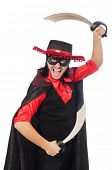 foto of zorro  - Young man in carnival coat with sword isolated on white - JPG