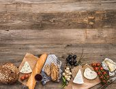 image of french culture  - French snacks on a wooden table with space for text - JPG