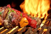 picture of kababs  - Mixed Meat And Vegetables Kebabs On Flaming Charcoal Barbeque Grill Background - JPG