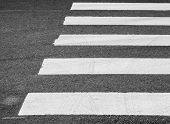 image of pedestrian crossing  - Dark gray asphalt road with pedestrian crossing road marking selective focus with shallow DOF - JPG