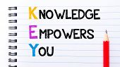 pic of empower  - KEY as Knowledge Empowers You Text written on notebook page red pencil on the right - JPG