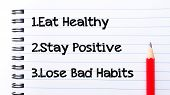foto of  habits  - Eat Healthy Stay Positive Lose Bad Habits Text written on notebook page red pencil on the right - JPG
