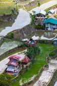 stock photo of ifugao  - Village houses near rice terraces fields - JPG
